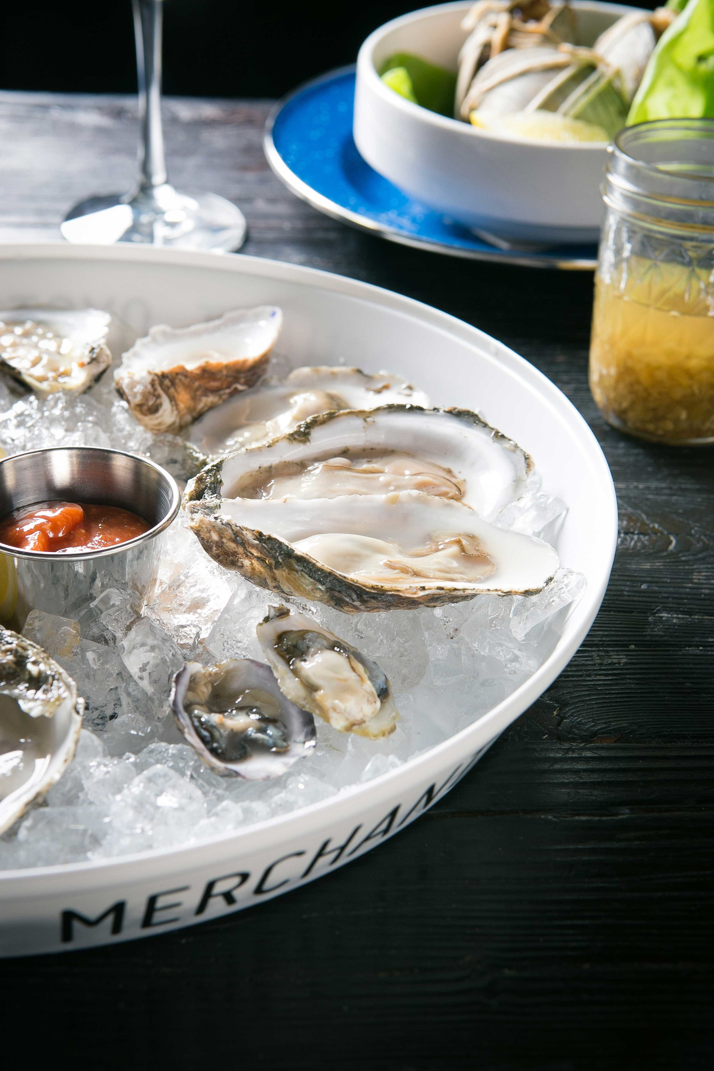 Fresh oysters and homemade cocktail sauce in Merchant tray.