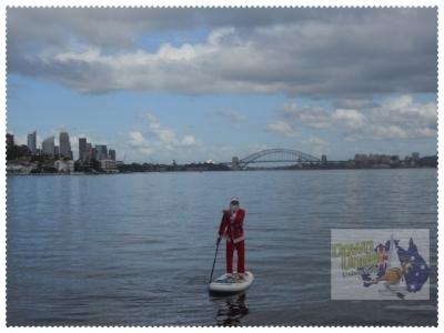 Brian aka Santa, paddleboarding on Sydney Harbour 25th December 2015.