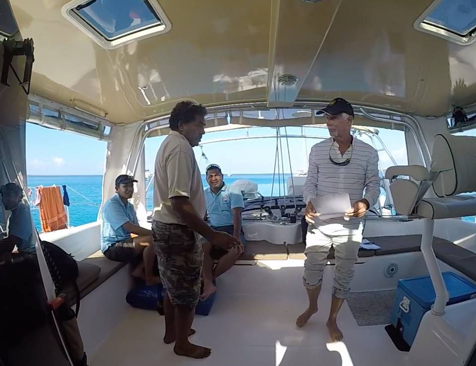 Herve and the officials aboard Songlines which is anchored in Lifou.