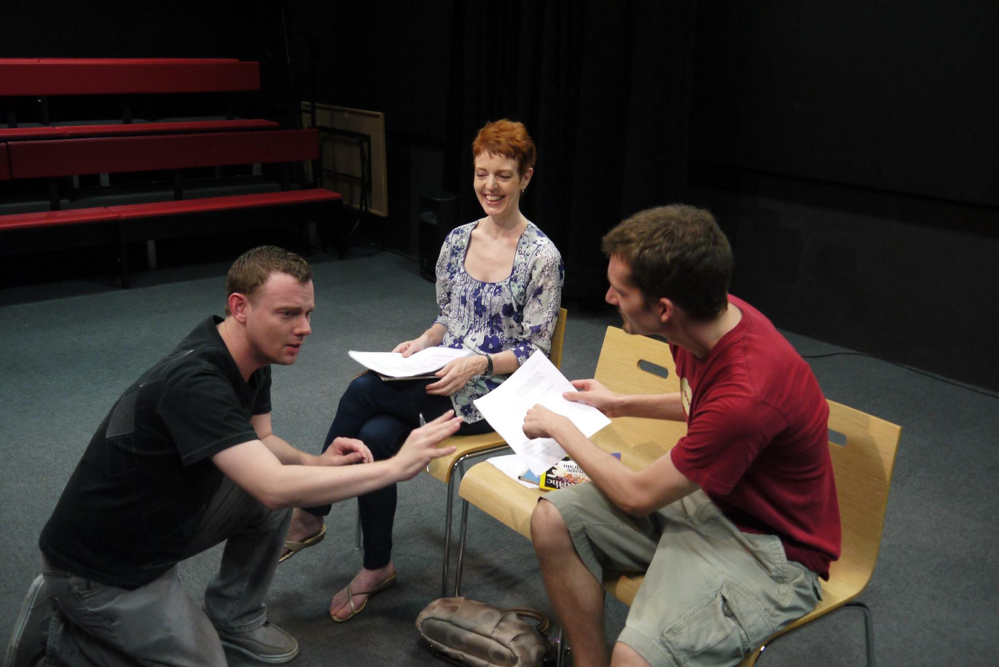 Erik Champney (L) with Wendy Hammond and Steven Koernig during a rehearsal for his play,  If You Don't Care . NYU Tisch Asia, Singapore.