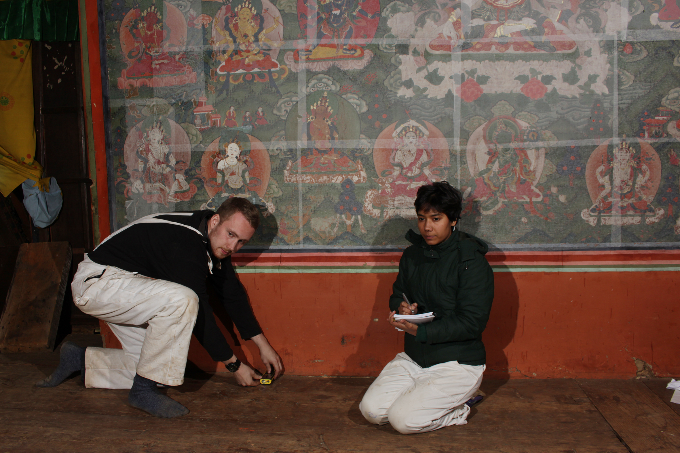 Measuring surface ares at the Tango Monastery, Bhutan