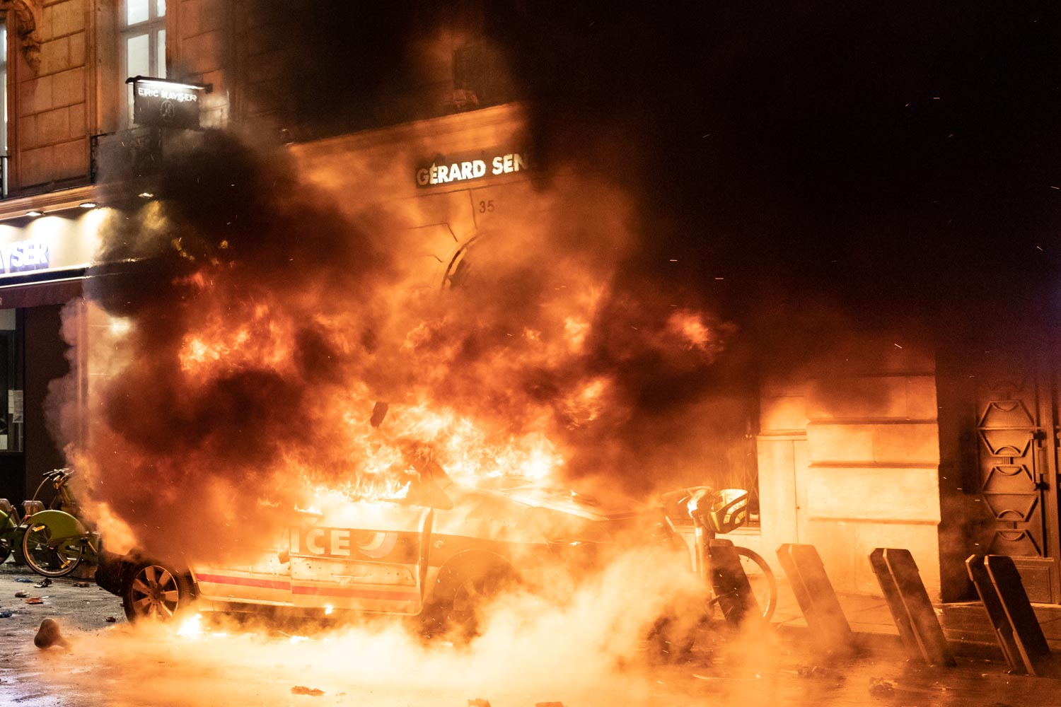 Rioters set fire to a Police nationale van in Central Paris.