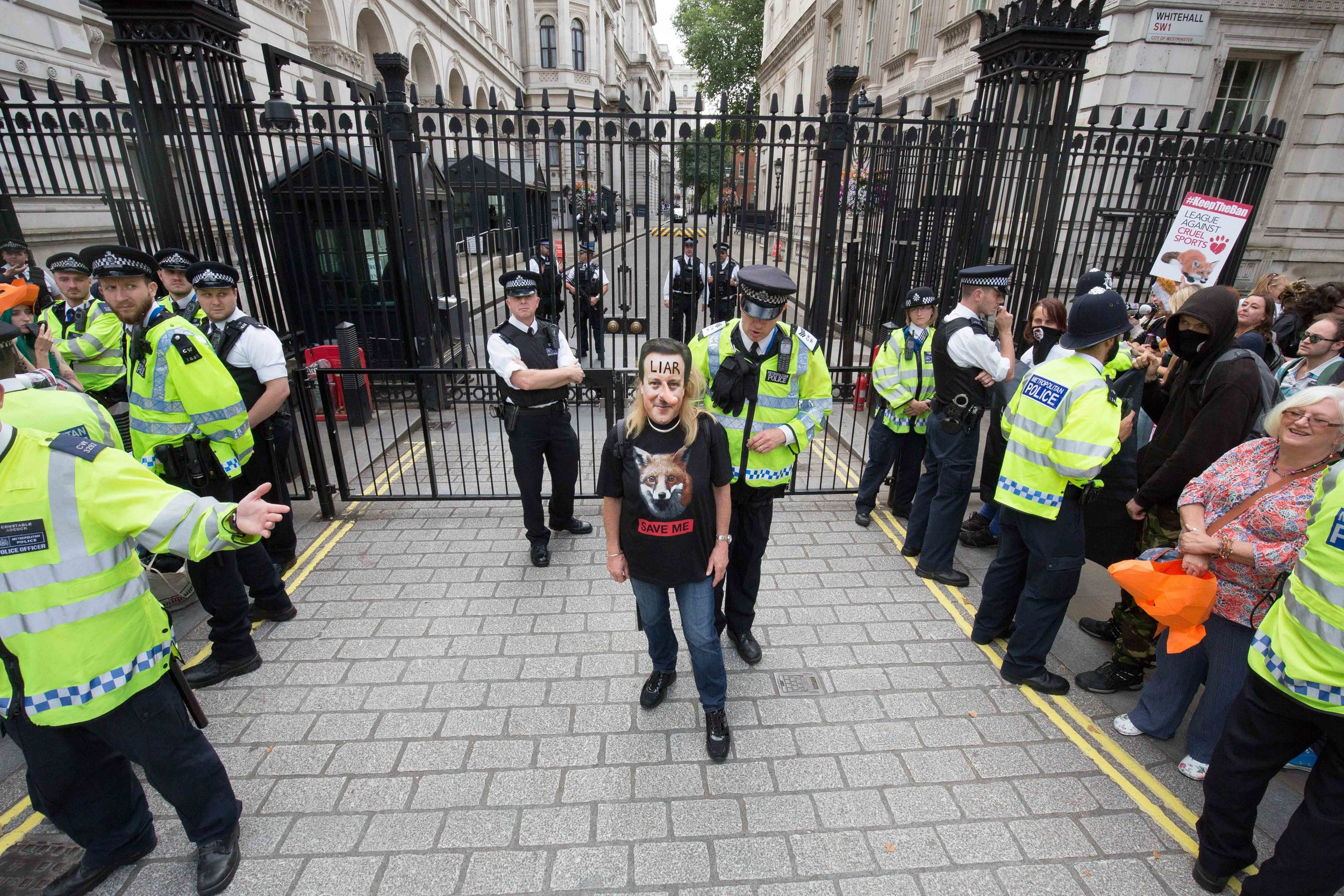 Save Me – protesters gather outside Downing Street to urge the Prime Minister to back the ban on hunting with dogs. This is part of the series awarded in the British Life Photography Awards 2015. London, England - July 15 2015.