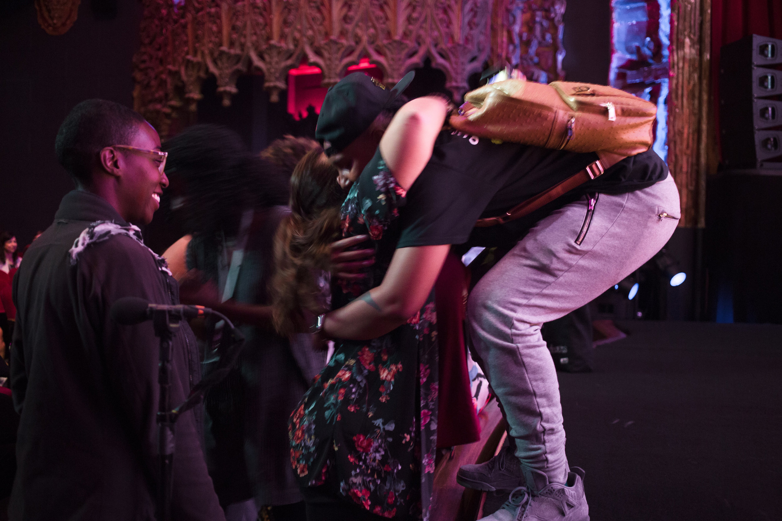 Lena Waithe hugging an audience member from the stage