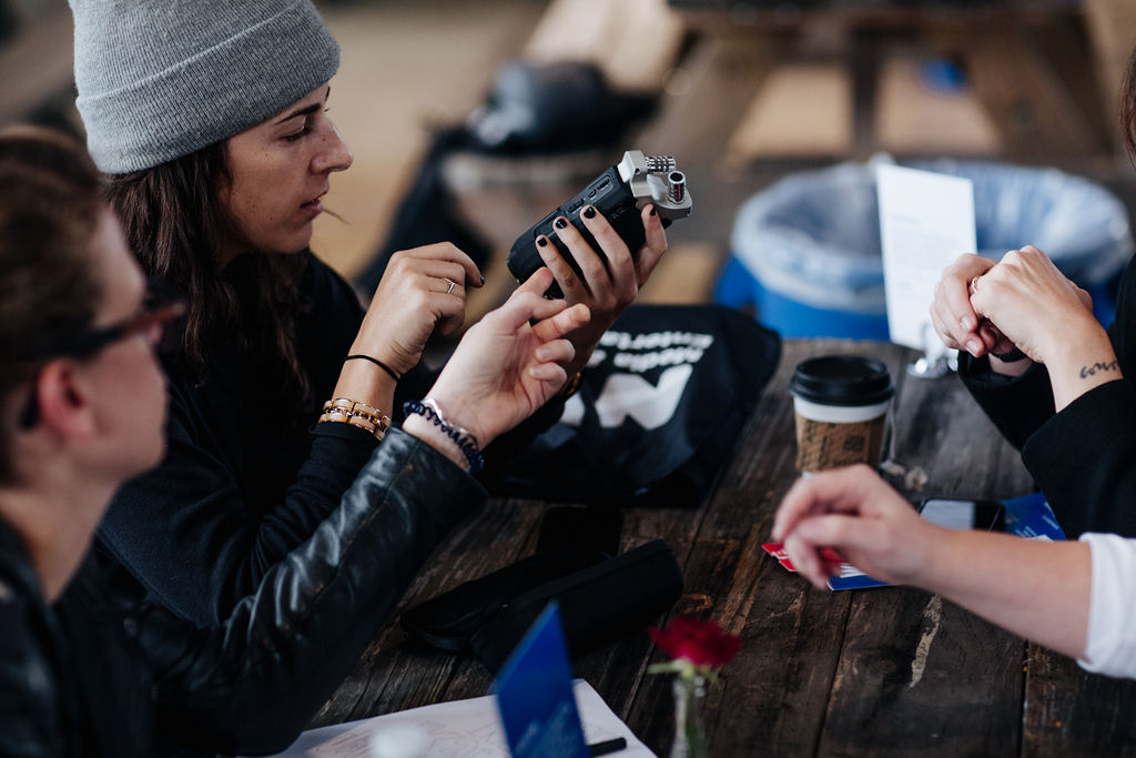 Two attendees examining an audio recorder