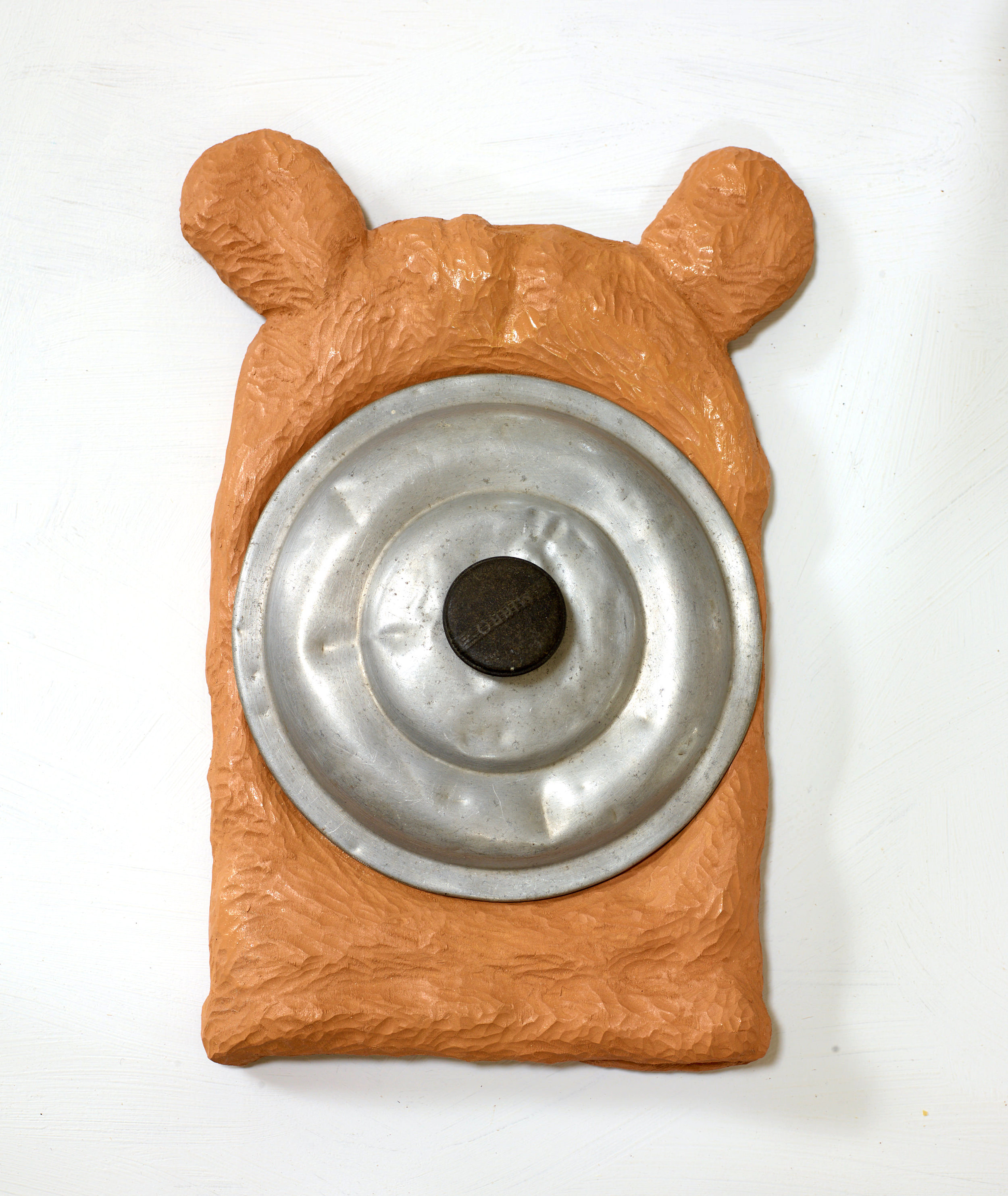 mammal, carved and painted wood with pot lid, 2016