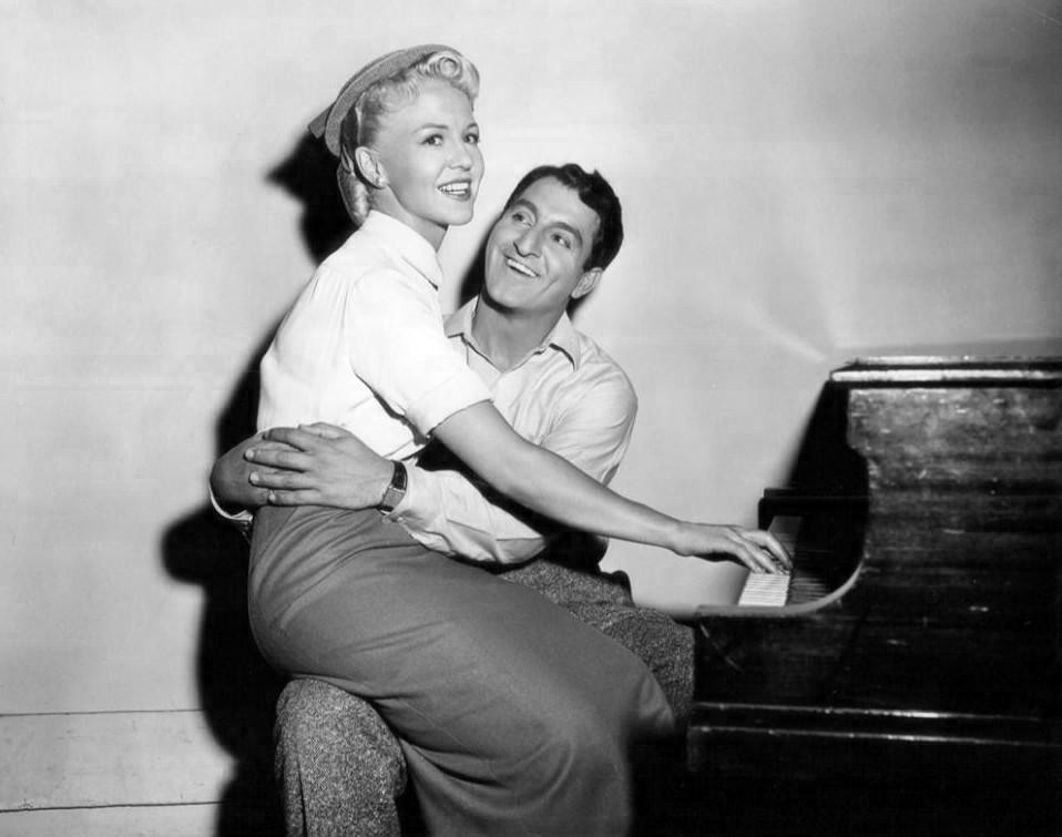 Peggy Lee and Danny Thomas joking around on the piano.