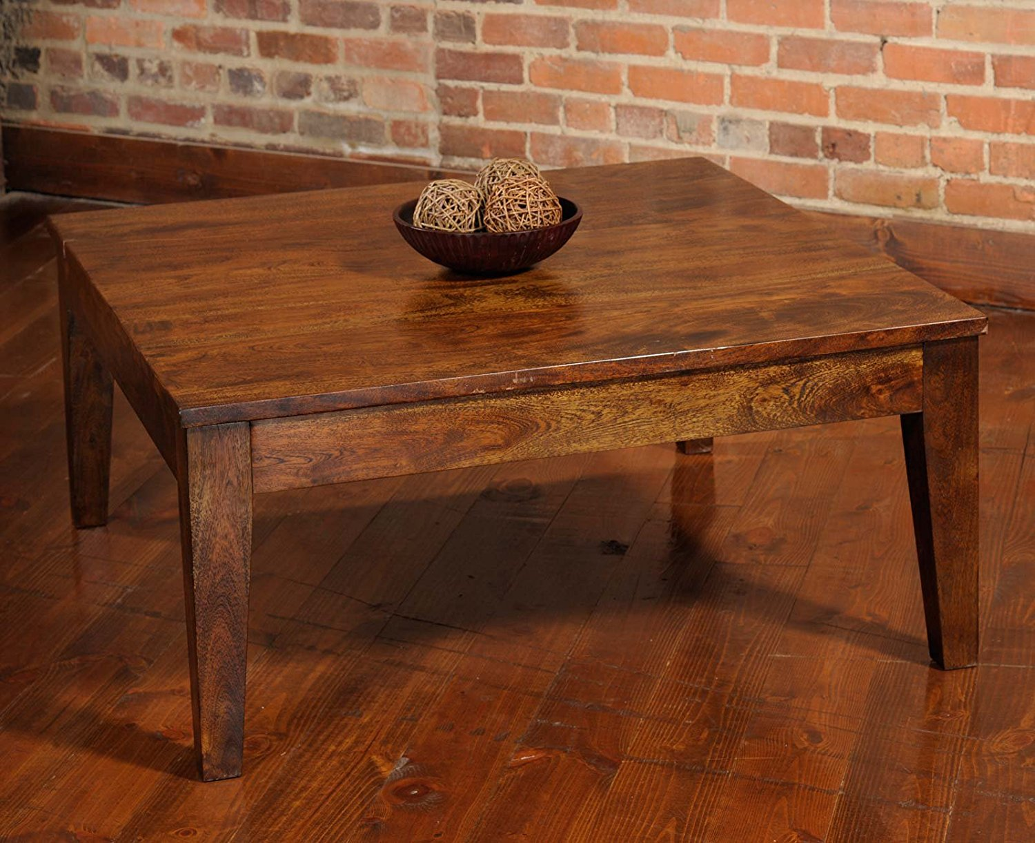 Wood Coffee Table - Amongst Marilyn's collection was a coffee table believed to have been sourced (handmade) from Mexico. It is difficult to find something identical because the piece is so unique, but with its striking lines and distinctly non-manufactured look, I think this fits the bill.