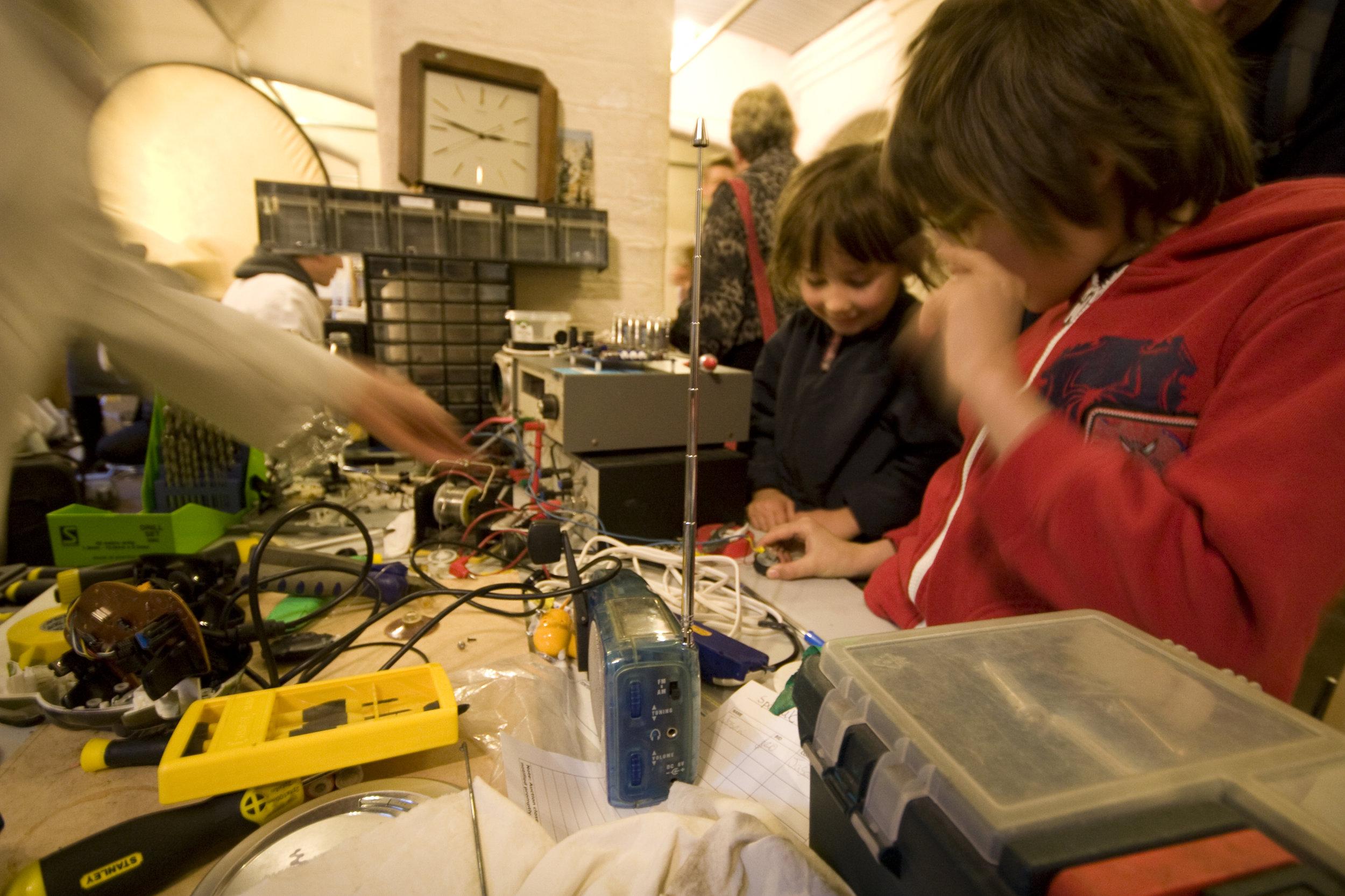 kids getting repairs done at the repair workshops 2011