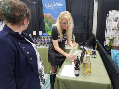 Marianne working her magic for WishGarden Herbs at the Portland, OR Women's Show.
