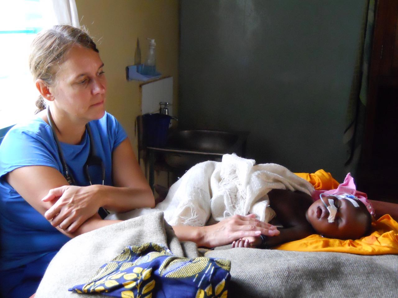 Rebecca monitoring baby with malaria.