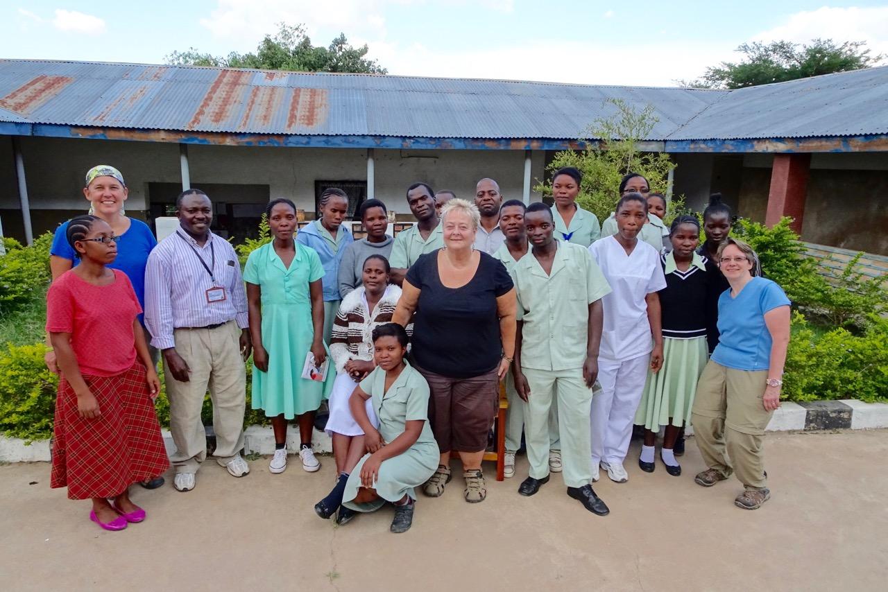 Rebecca, Debbie, and Dr. Gerlach with Mvimwa Holy Spirit Abby's Medical Staff.