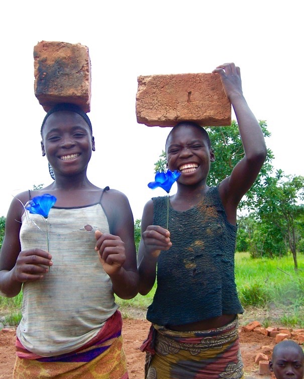 Zambia girls helping to build school.