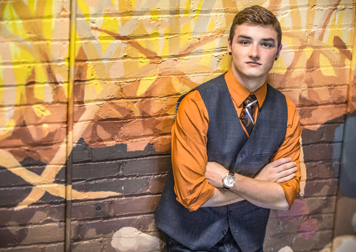 Portrait-HIgh-School-Seniors-boy-young-man-against-orange-mural-205.jpg