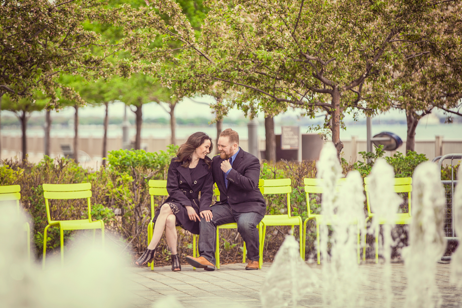 Portrait-Engagement-man-and-woman-in-cafe-on-detroit-riverwalk-with-fountain-173.jpg