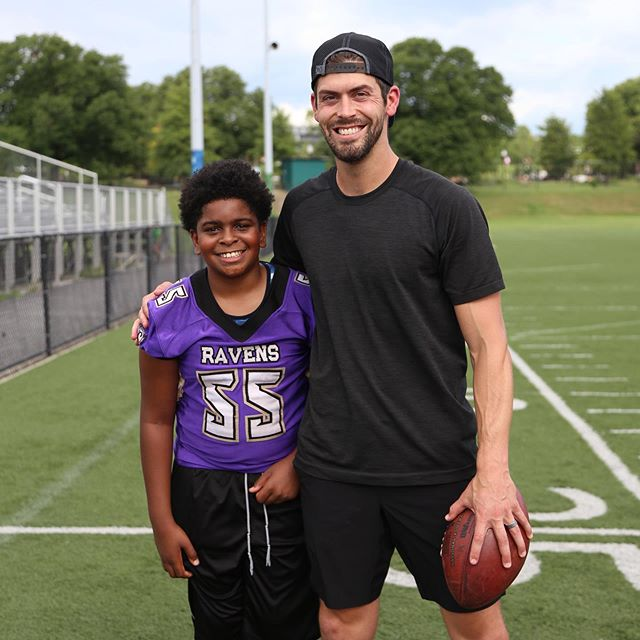 #ALGP Junior Wanderer, Dominic with @ravens kicker Justin Tucker at today's Living Classrooms event in partnership with @lululemon & @divayogi  Photography by @fluffypoppostcards  #allusinwanderland #exploremore #baltimore #bmore #mybmore #thebmorecreatives #ravens #community