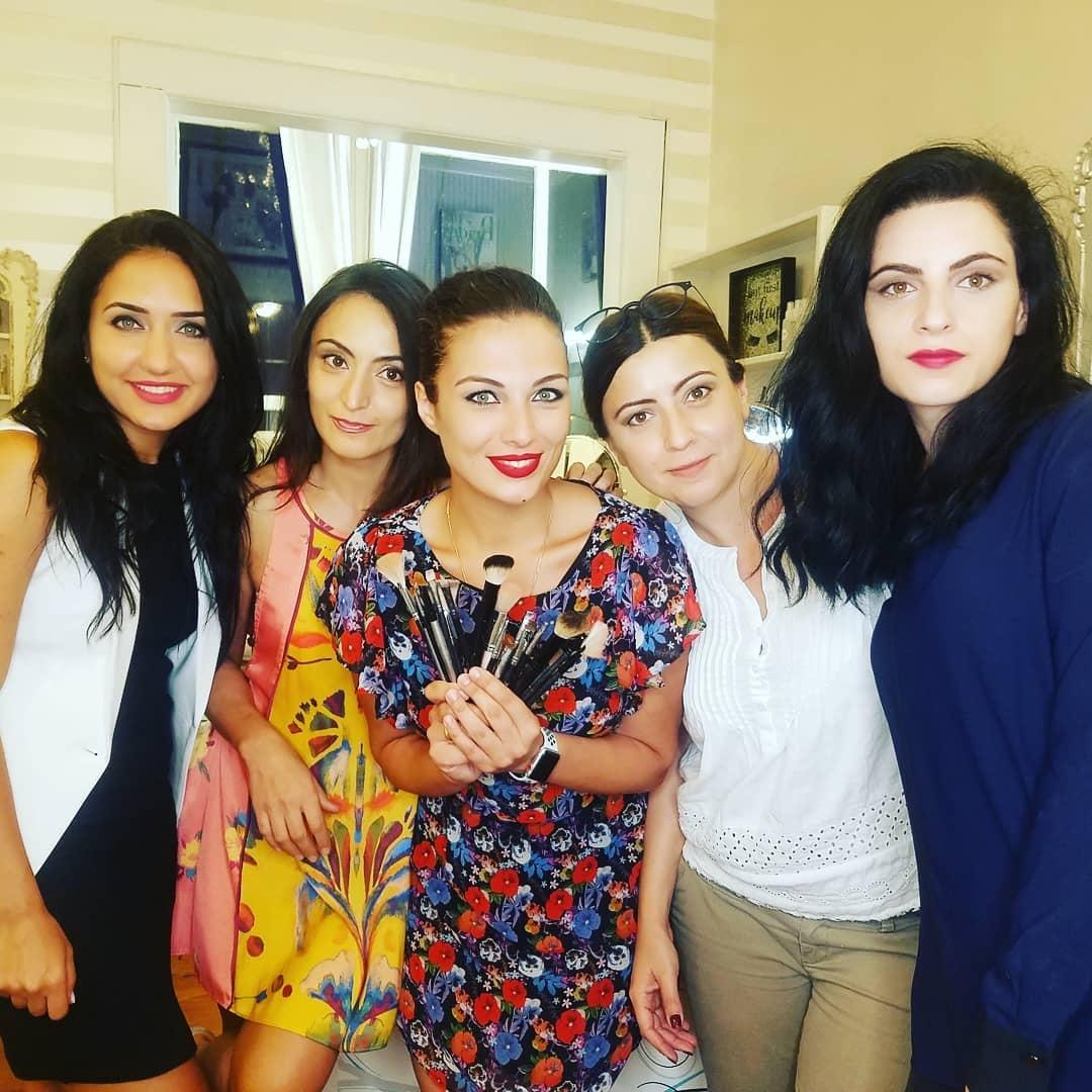 Women holding makeup brushes