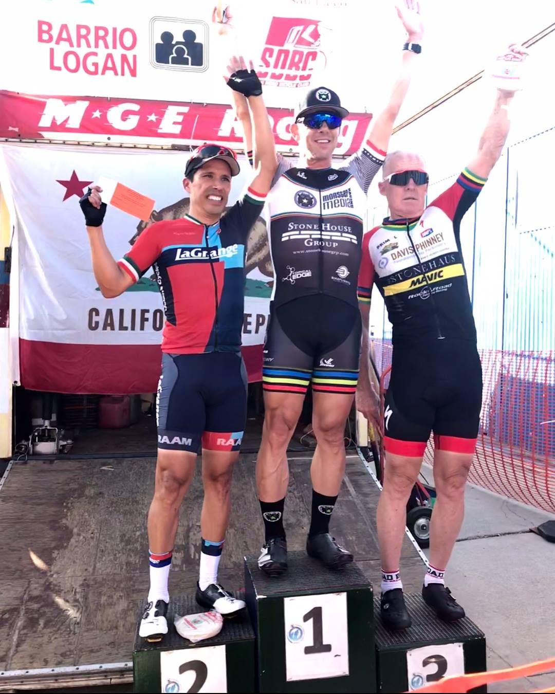 Victor and his aero socks on the podium at Barrio Logan