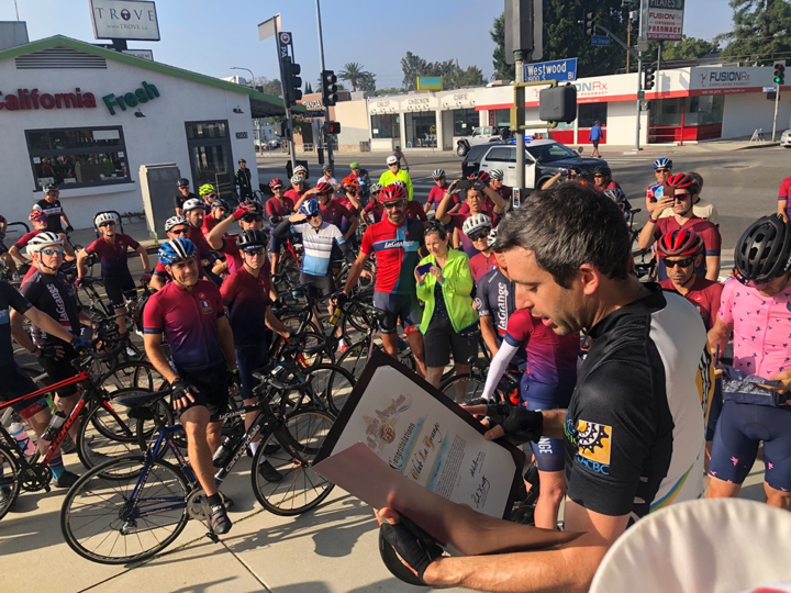 Eric Bruins, Transportation Policy Director for Councilmember Mike Bonin, City of Los Angeles, presents Velo Club La Grange a proclamation honoring the club for its 50th anniversary.