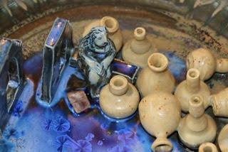"plate with small pots   stoneware diameter: 12"" 2015   ""woh jo tumhare paas hai agar kuchh khaas hai toh zindagi ka ehsaas hai"""