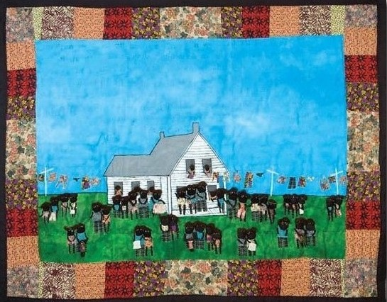 Jubilee 2003 pieced fabric and quilted fabric 7 ft x 6.5 ft  This work teaches viewers about Juneteenth which recognizes the end of slavery on June 19, 1865.