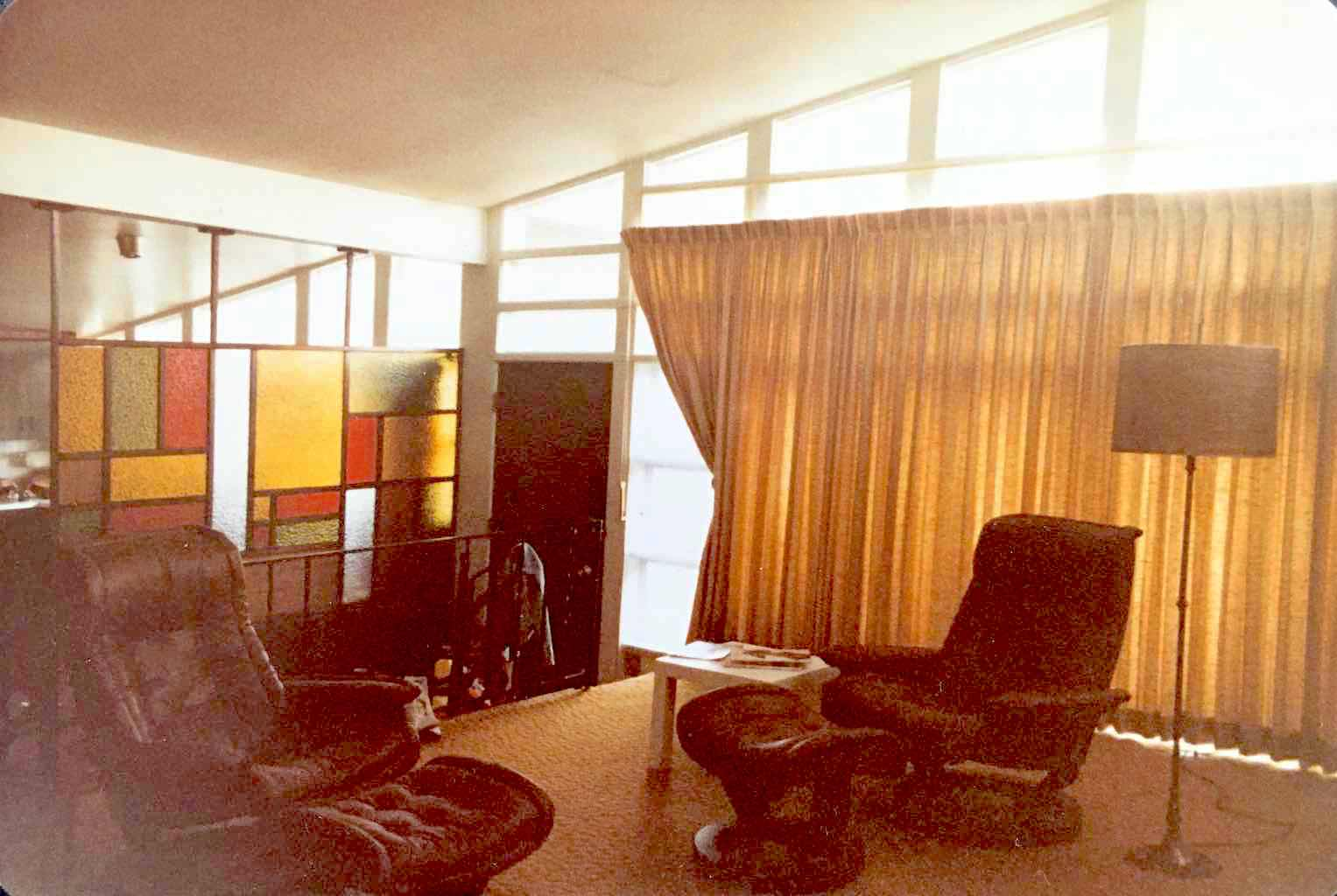 In this image you can see the thick curtains that blocked much of the light from entering the living room.