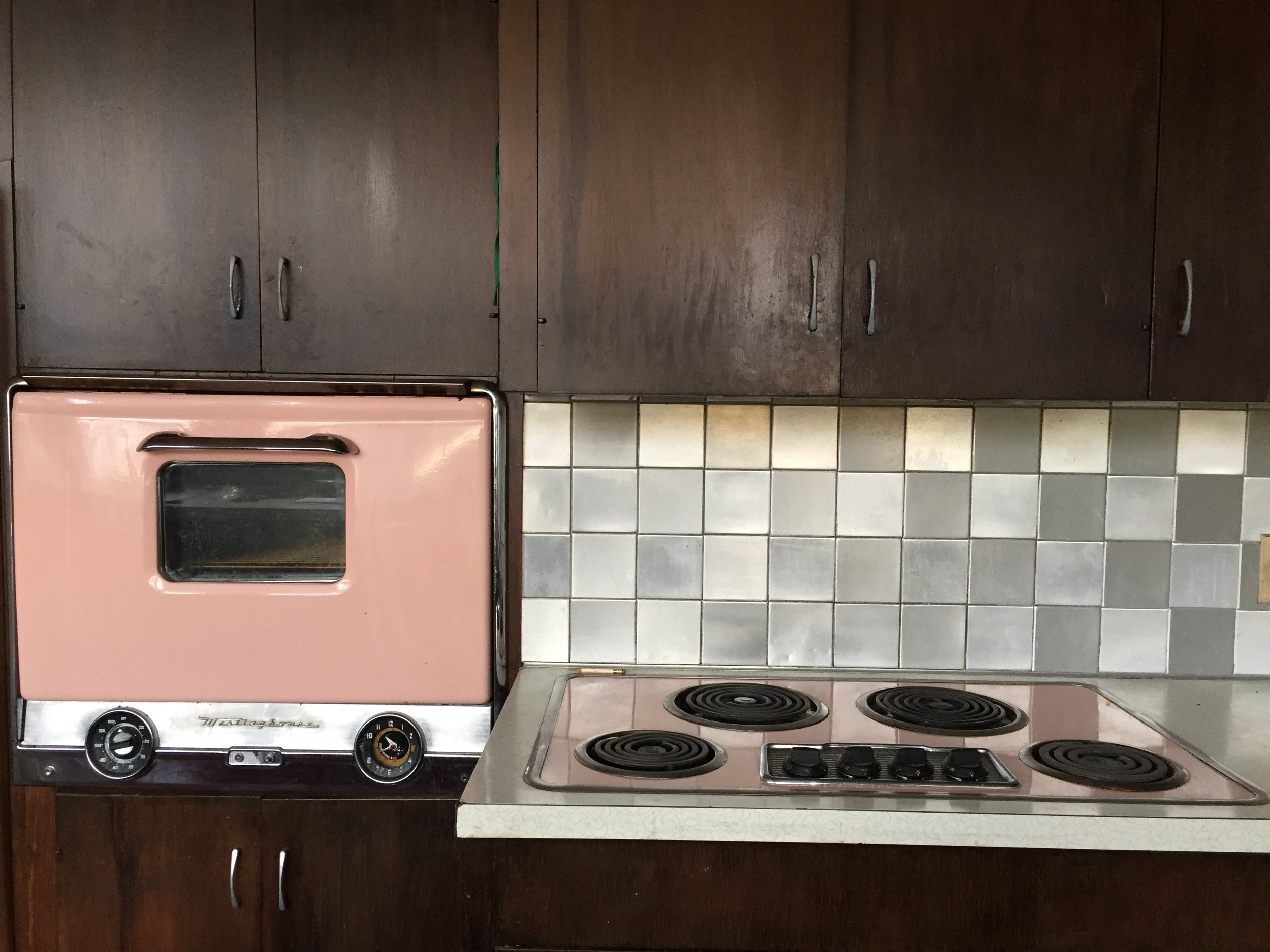 "In the Deza Estates home ads from the 1950s, they boasted ""the most up-to-date design in kitchens with the latest built-in appliances."" At this time, it was Westinghouse and ours were pink. The sink was also pink, but that was long gone by the time we moved in"