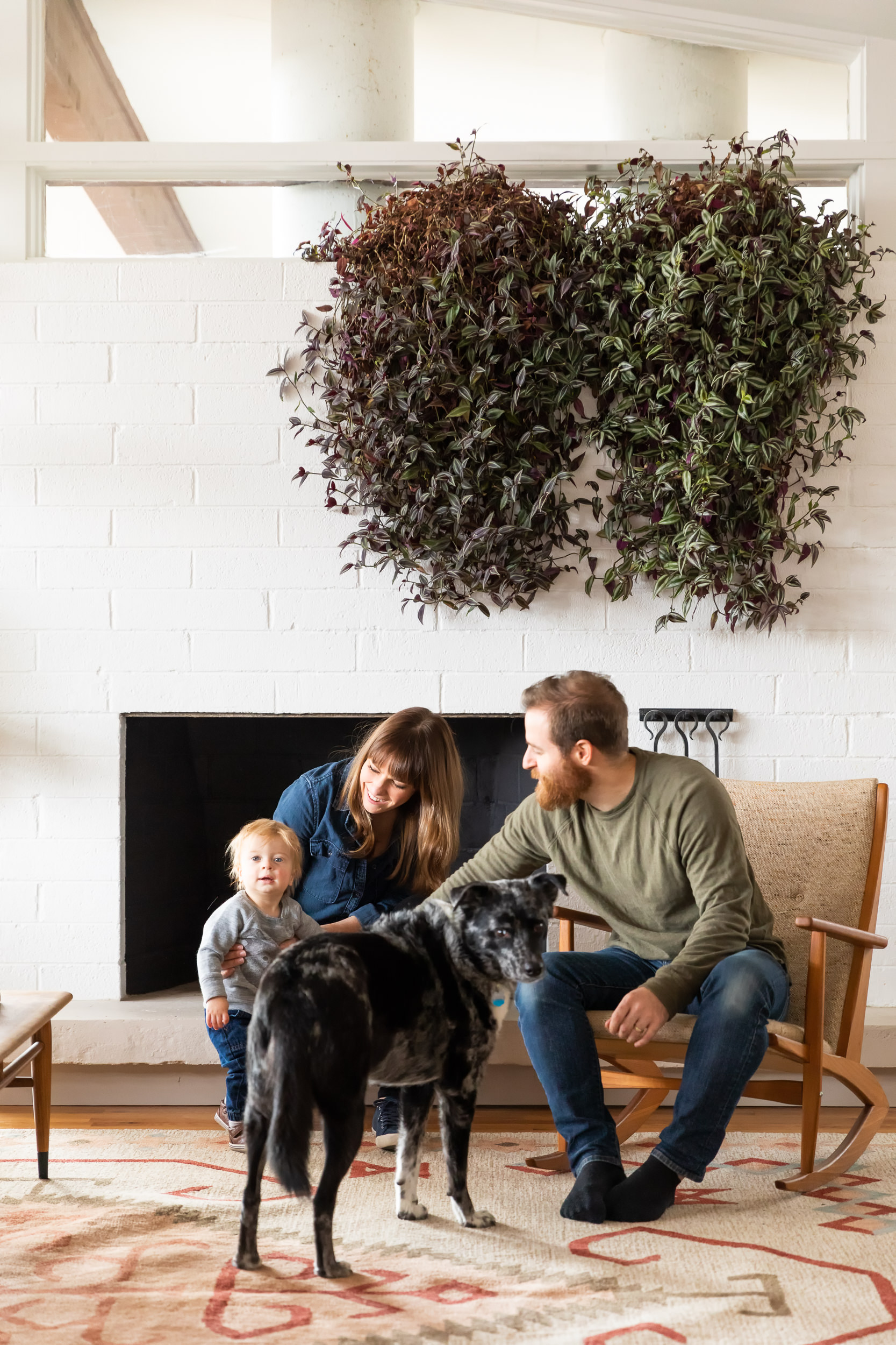 Danielle, Cole, their son, and the family dog in the home's living area.