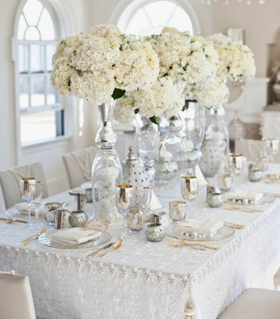 I love the idea of having a delicate overlay for the reception tables.  Pic via Pinterest.