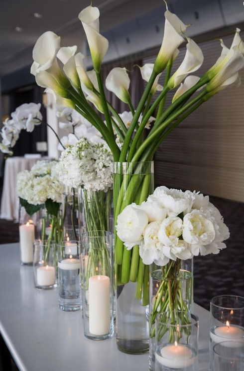 love the classic and clean look of these arrangements. Via Pinterest.