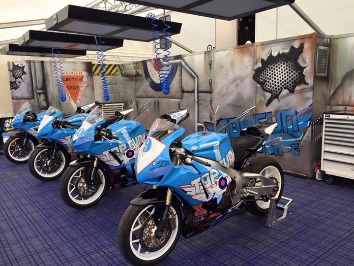 Topgun Racing   Originally formed in 2011 from mainly serving members of the Royal Air Force, Topgun Racing started to compete in motorcycle road racing at the world famous Isle of man TT course. The team's discipline and professionalism and sheer hard work ethic shone out from the very start. Not only were the team popular with the fans, with their distinctive and immaculately turned out machines, but also in no time at all were amongst the best privateer teams in the paddock!