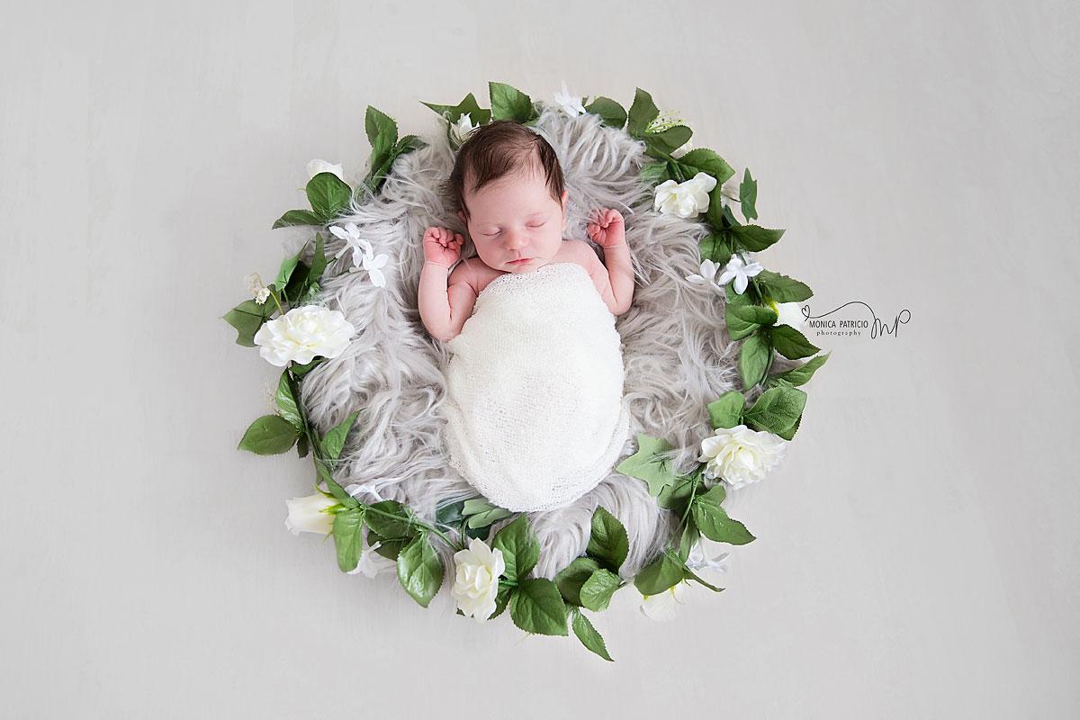 newborn baby and flowers