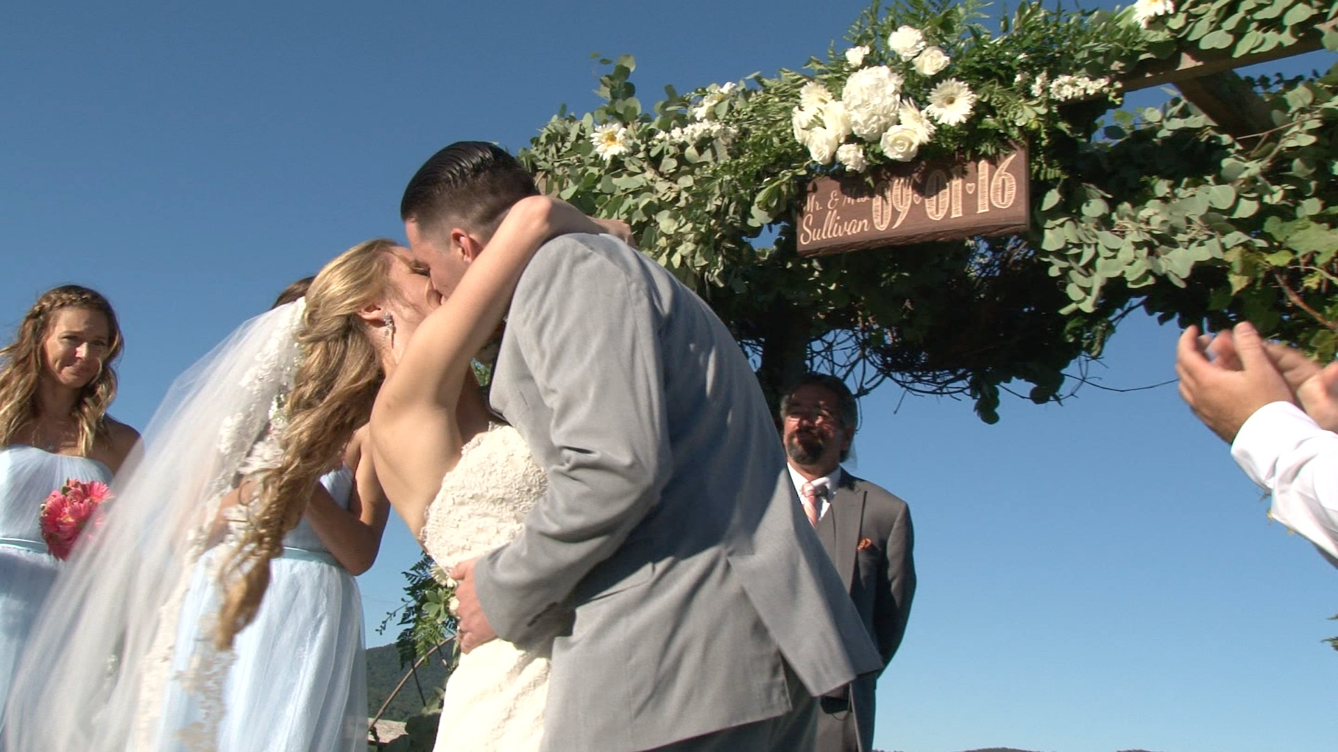 bride and groom first kiss