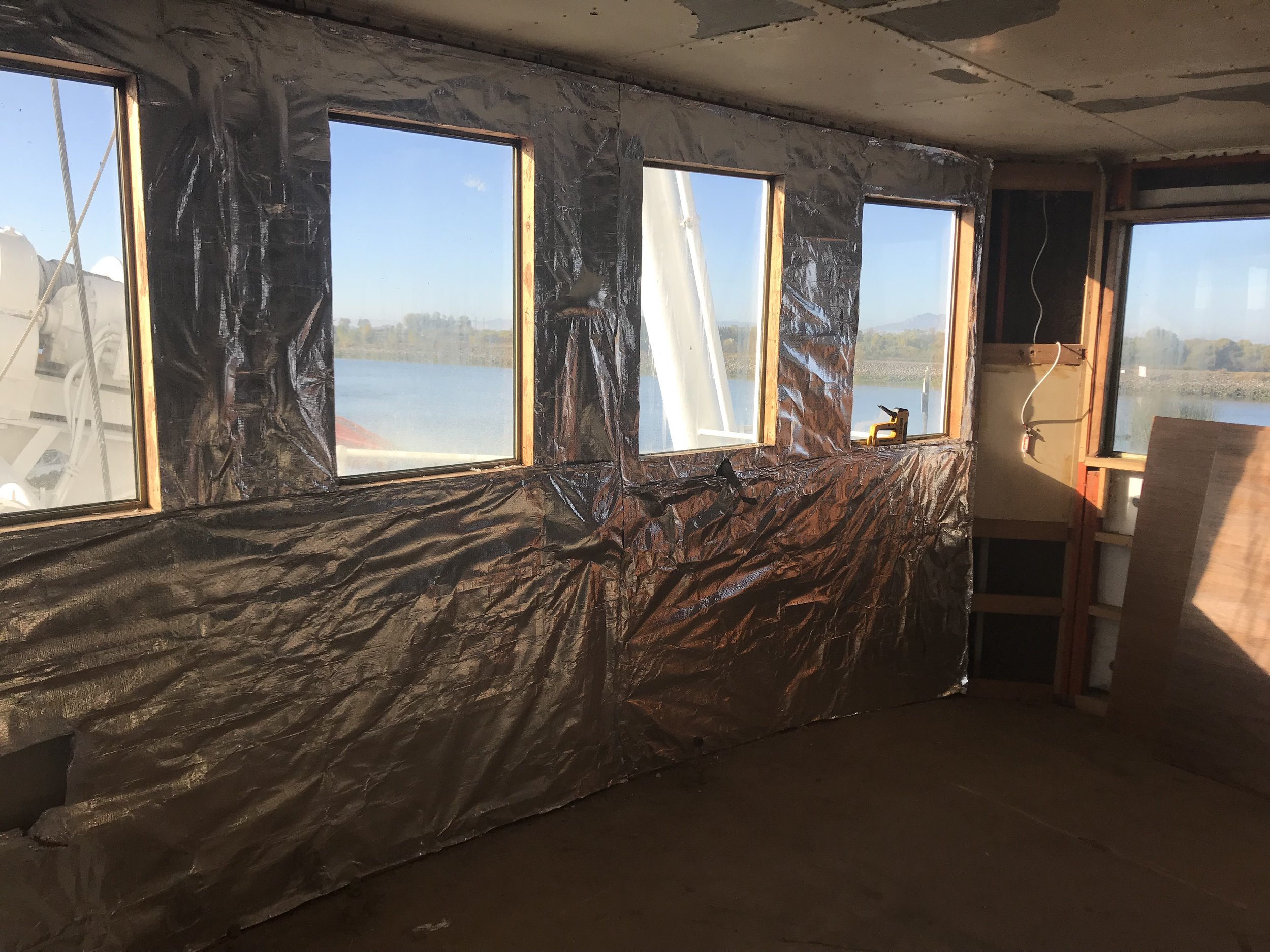 Repurposing begins Fall 2017. Old cork insulation is kept. Closed cell foam sprayed and foil barrier added. Drop ceiling removed.