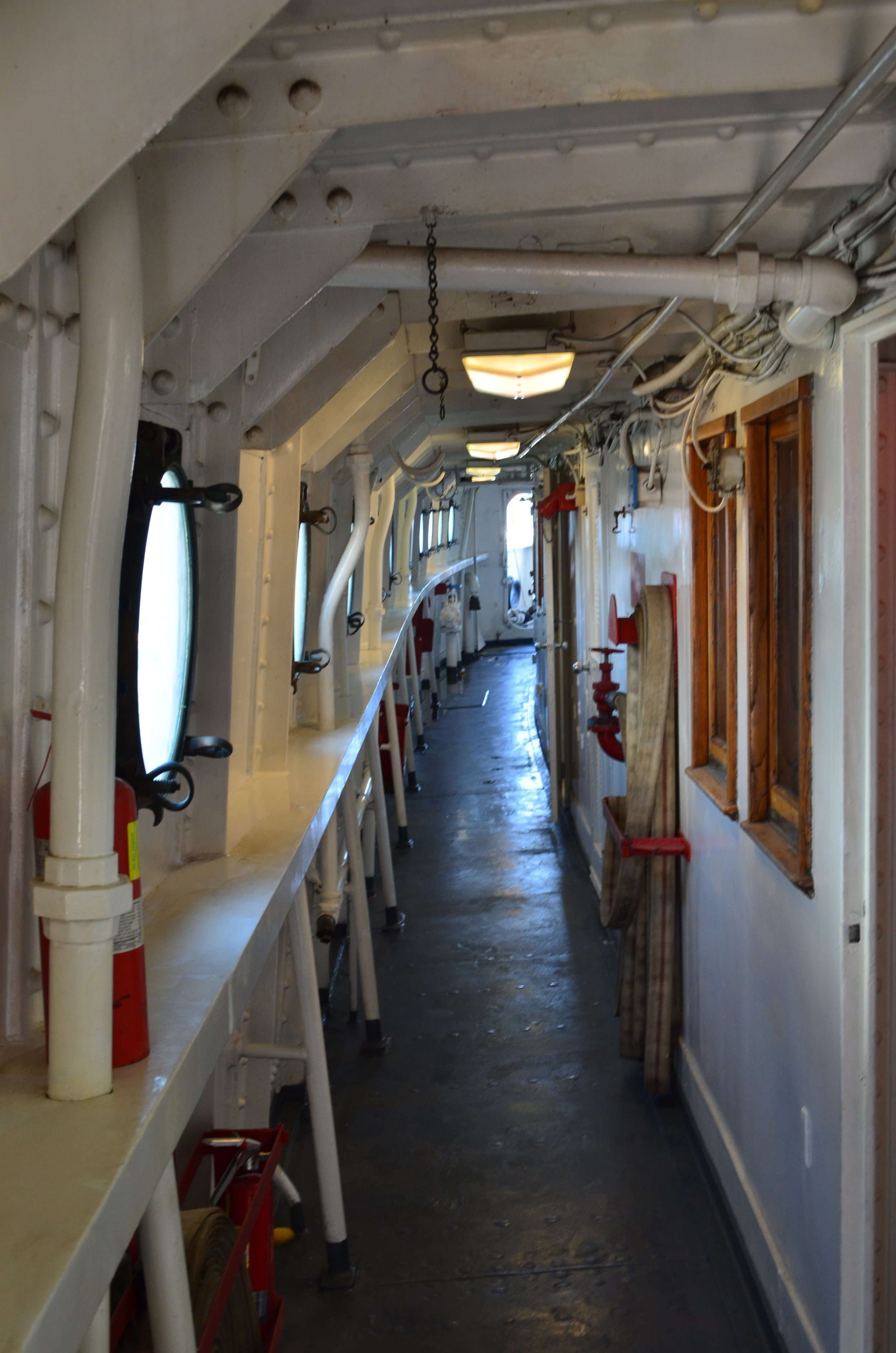 Starboard passage on the 01 deck looking aft. Summer 2017. Tracing wires in the ceiling