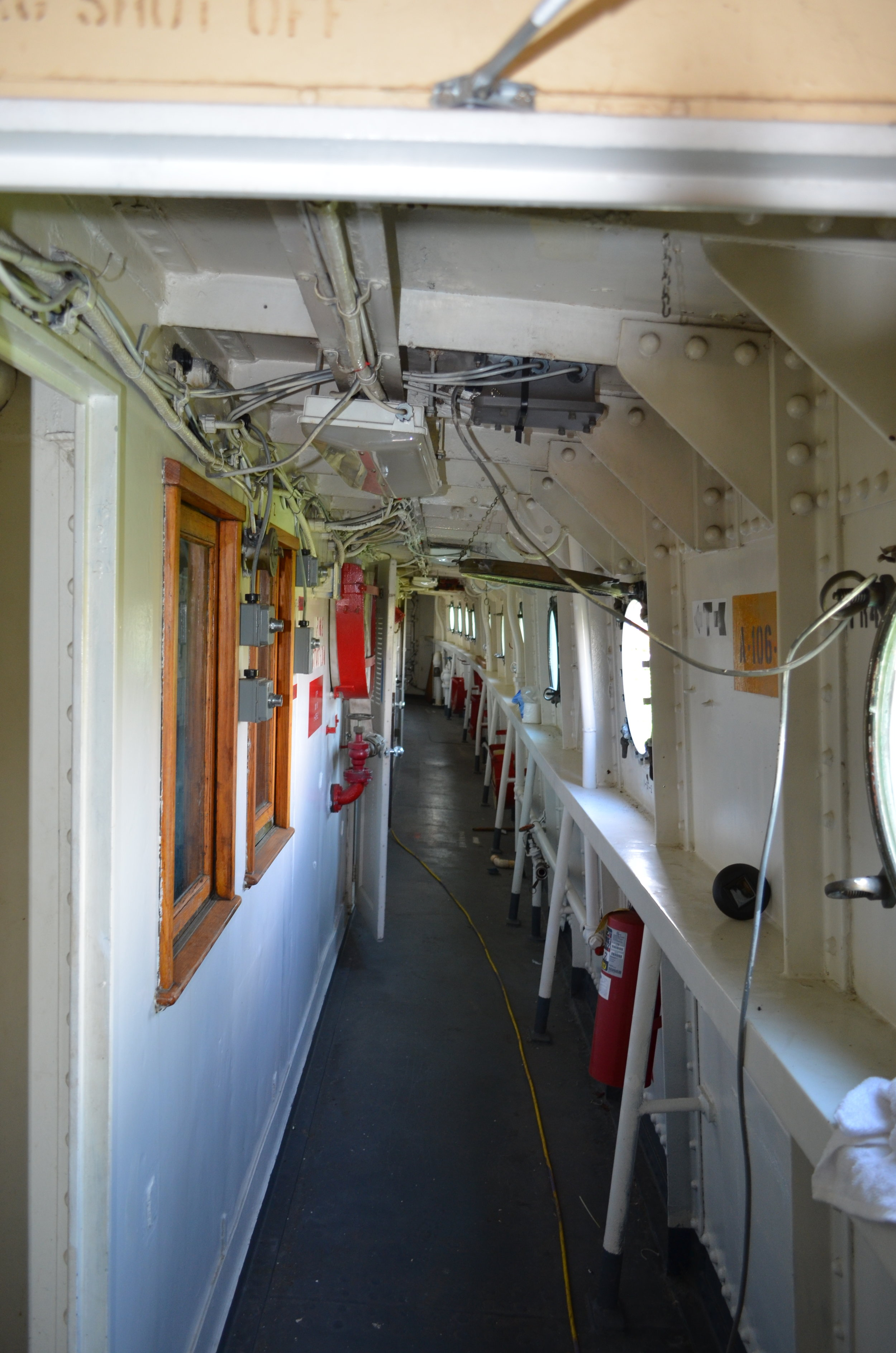 Port passage on the 01 deck looking aft. Summer 2017. Tracing wires in the ceiling