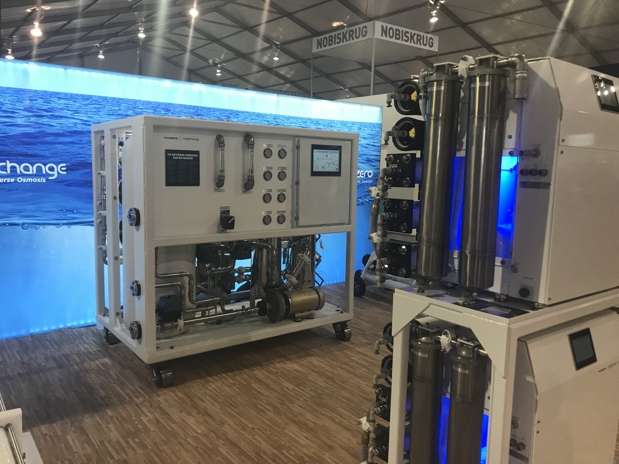 A large watermaker from Dometic as presented at the 2017 Ft. Lauderdale Boat Show. Smaller systems in the foreground.