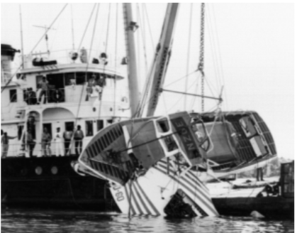 Fir raises a CG 40- footer and hydroplane which had collided during a 1958 race on Lake Washington. Photograph courtesy Coast Guard Museum Northwest.