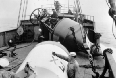 Preparing scraped and repainted buoys for relief. Photograph courtesy National Archives, Seattle.