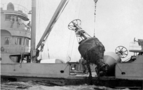 Bringing aboard a double bluff whistle buoy. Photograph courtesy National Archives, Seattle.