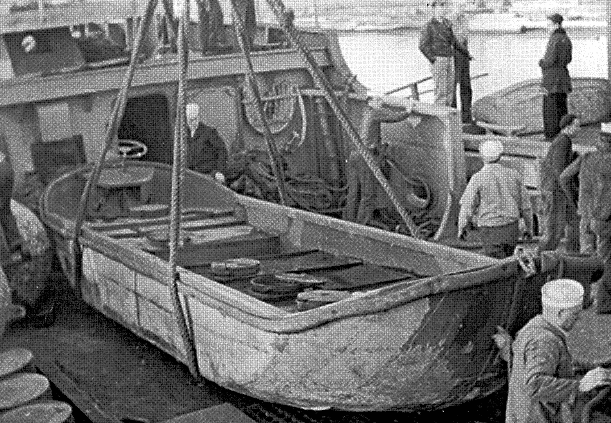 Boat is prepared for supplying outlying unit, 1943. Photograph courtesy of National Archives, Seattle.