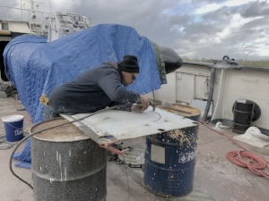 Joe carved the new porthole free-hand. He used a plasma cutter on metal we removed from the lower fantail.