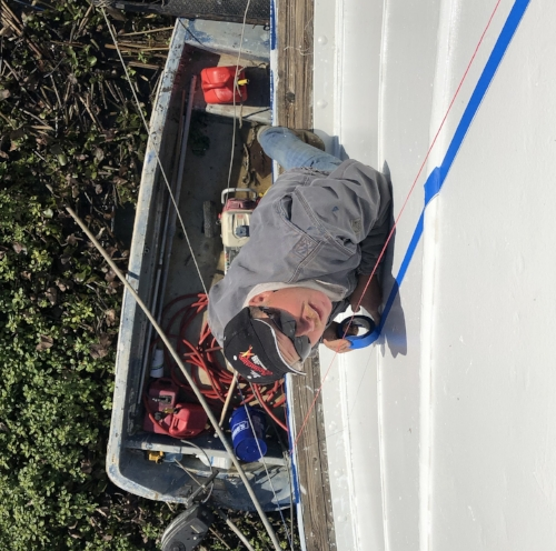 Chris tapes the hull for striping.jpg