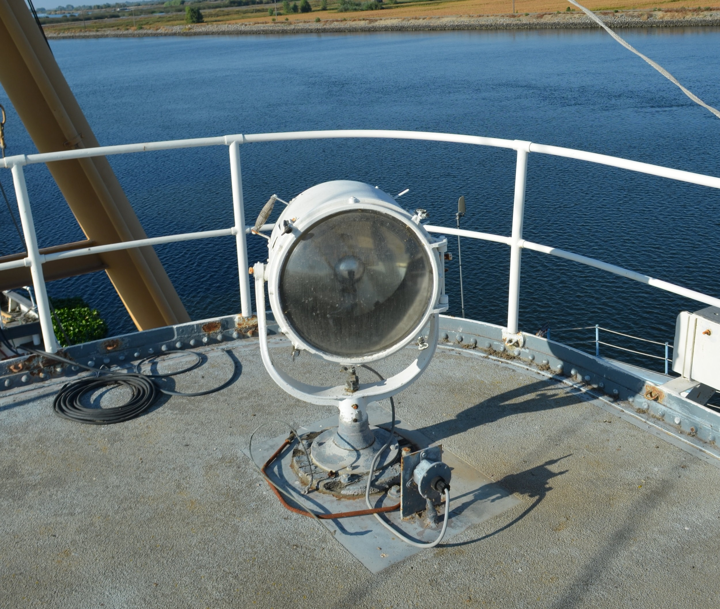 The starboard spotlight as it existed at the time of purchase. Note the vertical control bar detached and sitting on the deck.