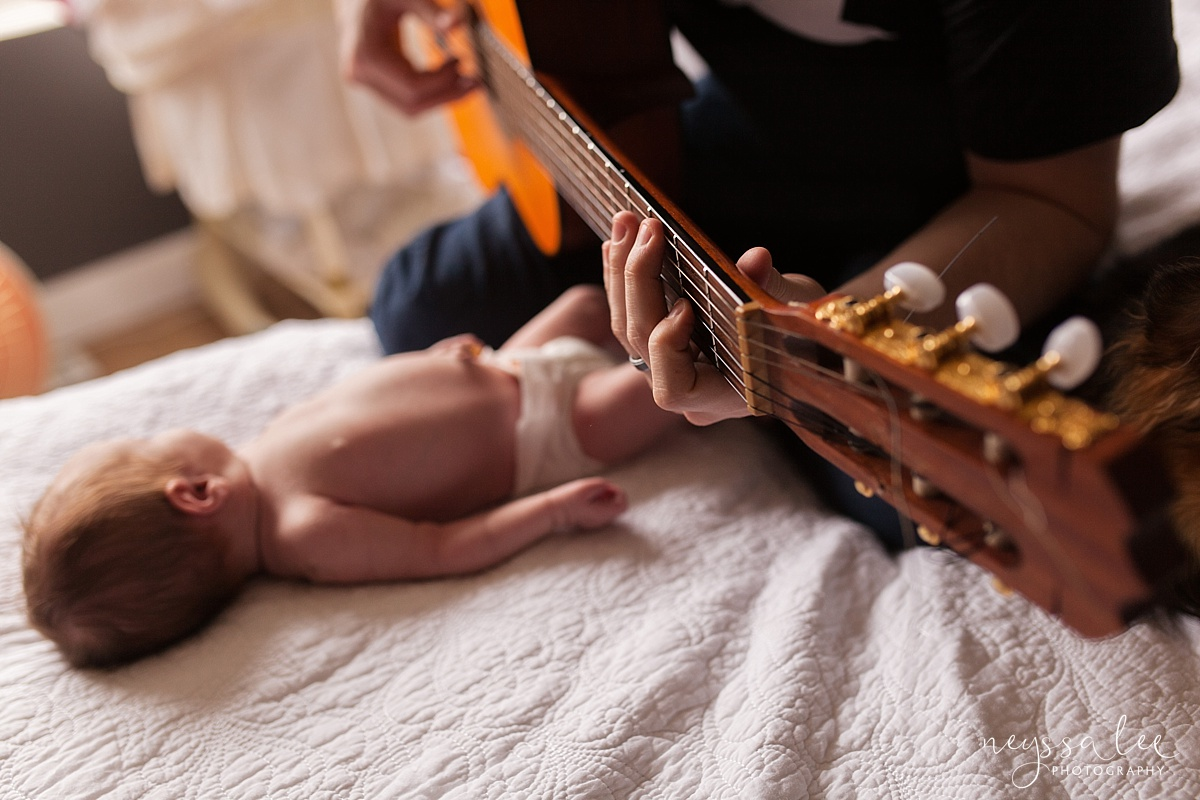 Dad playing guitar to newborn baby girl, Family of 5, newborn baby girl, Snoqualmie Newborn Photographer