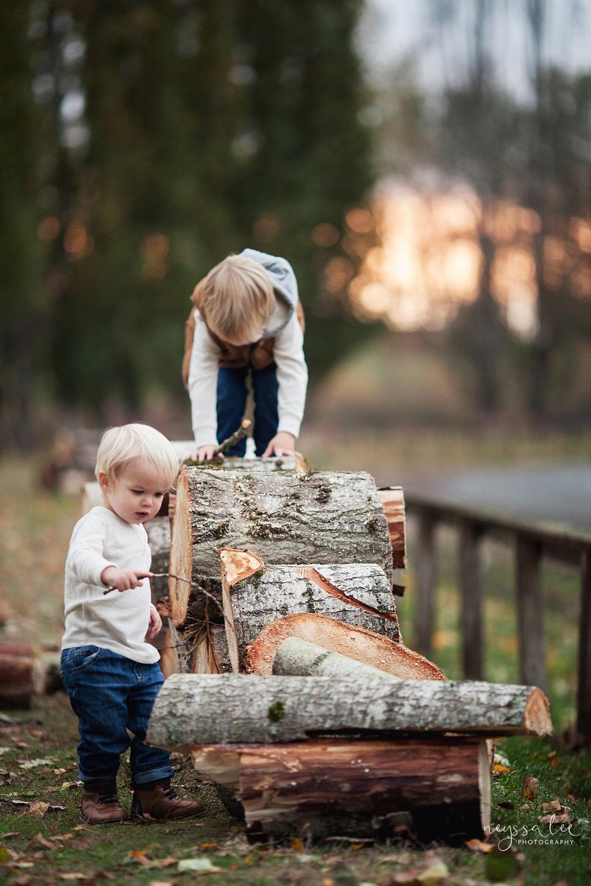 Neyssa Lee Photography, Snoqualmie Family Photographer, Fall Family Photos, boys playing on woodpile