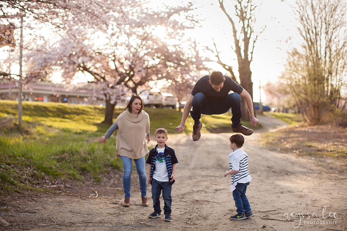 Family Photos by the River at Sunset, Neyssa Lee Photography, Snoqualmie Family Photography, Family of Four, Dad jumps over sons head