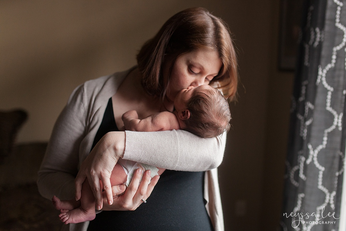 Neyssa Lee Photography, Awake newborn baby boy, lifestyle newborn photography, Seattle newborn photographer, mom kisses newborn baby