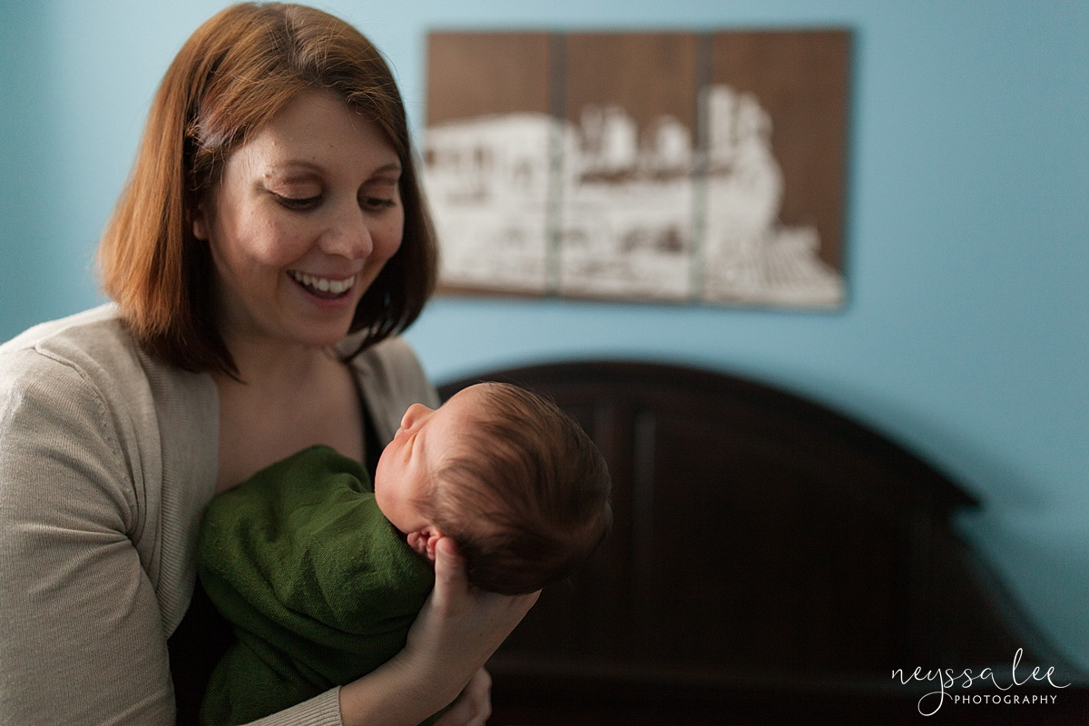 Neyssa Lee Photography, Awake newborn baby boy, lifestyle newborn photography, Seattle newborn photographer, mother smiles at newborn baby boy
