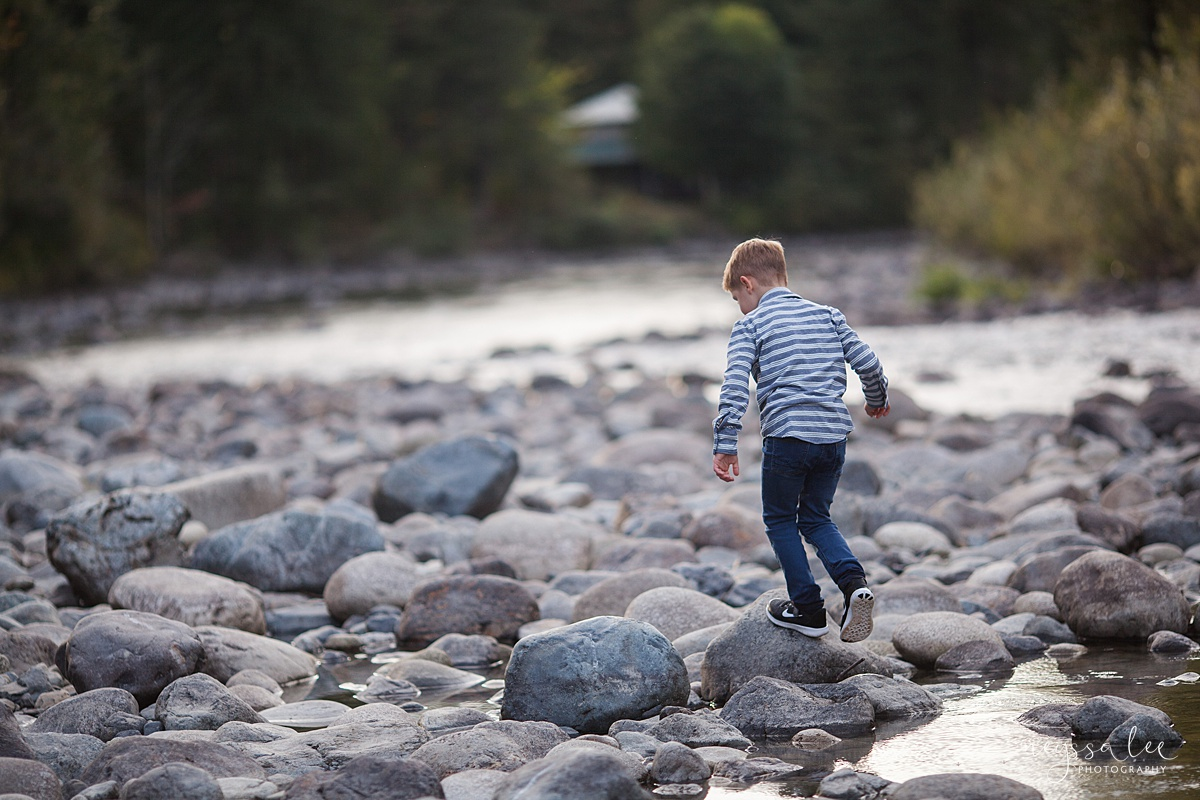 Snoqualmie Family Photographer, Neyssa Lee Photography, Fall Family Photos, Change of perspective on family photos, boy playing at the river